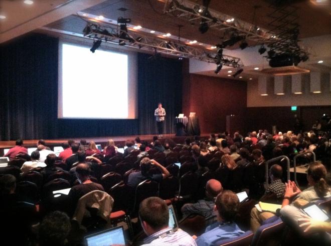 """Adii Pienaar presenting on """"The Business of Code."""""""
